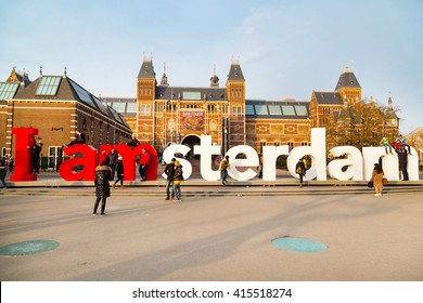 Amsterdam, Netherlands - March 31, 2016: People making photo in front of the sign, I amsterdam,  at Museumplein, Rijksmuseum