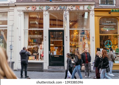 Amsterdam, Netherlands - March 31, 2019; De Wallen district; best known red-light district in Amsterdam. It consists of a network of alleys rented by prostitutes.