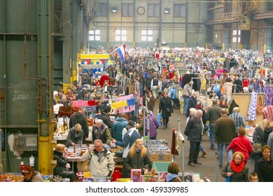 AMSTERDAM, NETHERLANDS - March 4. People shop at the indoor secondhand and vintage flea market in the IJ Hallen, biggest European market, on March 4, 2016 in Amsterdam. Popular monthly city event.