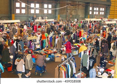 AMSTERDAM, NETHERLANDS - March 4. Second hand clothing in retro industrial factory building IJ Hallen (IJ-Hall), monthly event and biggest European flea outlet market, on March 4, 2016 in Amsterdam.