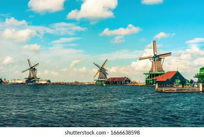 Amsterdam, the Netherlands , March 7th 2020:  Zaanse Schans 3 wind mills colorful landscape