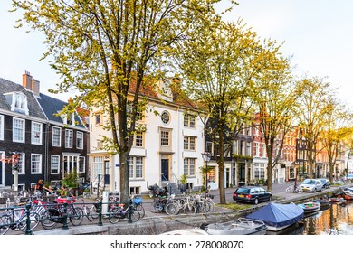 AMSTERDAM, NETHERLANDS - MAY 1, 2015:  Canal of Amsterdam in the evening. Amsterdam is the capital city and most populous city of the Kingdom of the Netherlands