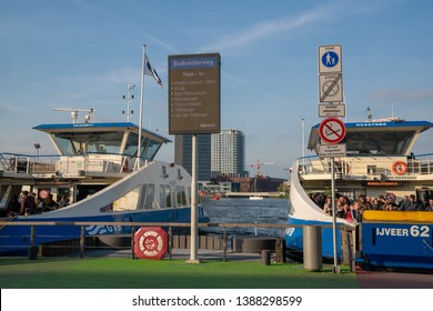 Amsterdam / The Netherlands - May 1. 2019: Free ferry service from Amsterdam Central Station to Amsterdam North across the IJ canal.