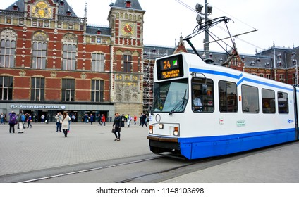 Amsterdam / Netherlands — May 10, 2017: a tram departing from the stop near Amsterdam Centraal, the central railway station of Amsterdam. Amsterdam Tram is one of the largest tram networks in Europe