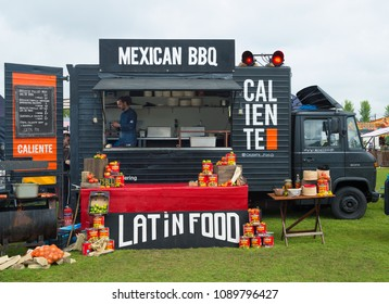 AMSTERDAM, THE NETHERLANDS - MAY 10, 2018: Mobile kitchen Caliente serves Latin American cuisine during the annual mobile kitchens weekend, held in the city's public Culture park.