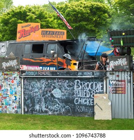 AMSTERDAM, THE NETHERLANDS - MAY 10, 2018: Mobile kitchen Plantage Onverwacht serves popular street snacks during the annual mobile kitchens weekend, held in the city's public Culture park.