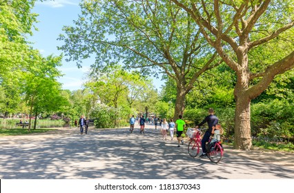Amsterdam, Netherlands - May 11, 2018: People Jogging In Vondelpark On A Sunny Day