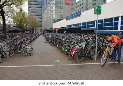 AMSTERDAM, Netherlands - May 13, 2017: Much bicycles standing on big parking place near the Central Station.