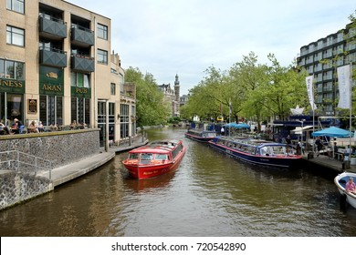 AMSTERDAM, NETHERLANDS - MAY 13, 2017: View of the Blue Boat Canal Cruises station