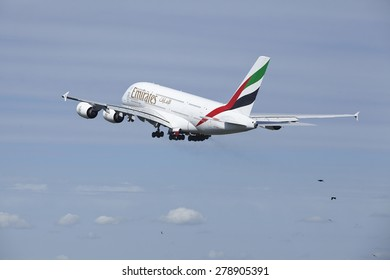 AMSTERDAM, THE NETHERLANDS - MAY, 13. An Airbus A380-861 of Emirates takes off at Amsterdam Airport Schiphol (The Netherlands, AMS) on May 13, 2015. The name of the runway is Polderbaan.