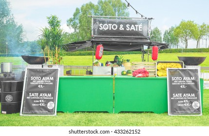 AMSTERDAM, THE NETHERLANDS - MAY 14, 2016: Mobile kitchen Hot Mama Hot sells popular Indonesian cuisine during the annual mobile kitchens weekend, held in the city's Culture park.