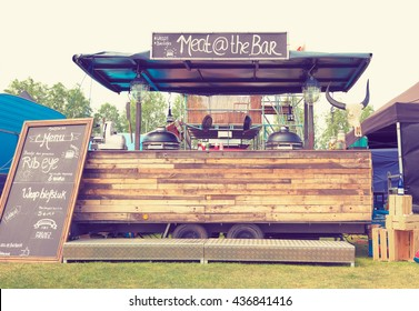 AMSTERDAM, THE NETHERLANDS - MAY 14, 2016: Mobile kitchen Meat at the Bar sells grilled meat during the annual mobile kitchens weekend, held in the city's Culture park. Instagram-like filter applied