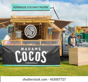 AMSTERDAM, THE NETHERLANDS - MAY 14, 2016: Mobile kitchen Madam Cocos sells homemade coconut pastry during the annual mobile kitchens weekend, held in the city's Culture park