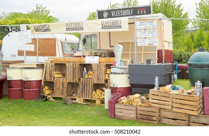 AMSTERDAM, THE NETHERLANDS - MAY 14, 2016: Mobile kitchen Vleeswolf sells biological grilled meat dishes during the annual mobile kitchens weekend, held in the city's Culture park
