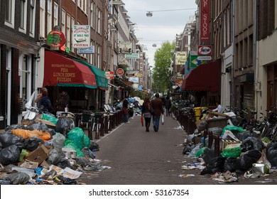AMSTERDAM, THE NETHERLANDS - MAY 15: Garbage pile up during the week long workers strike that ended today May 15, 2010, in Amsterdam, The Natherlands