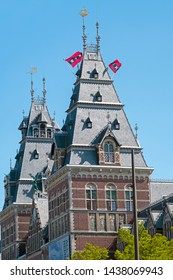 Amsterdam, Netherlands - May 16, 2019: The flags from Amsterdam in the Netherlands on the towers of the Rijksmuseum in Amsterdam the Netherlands