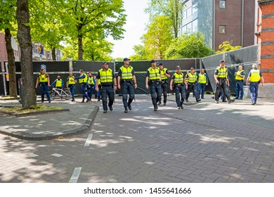 Amsterdam, Netherlands - May 16, 2019: Police force from the Netherlands in action during an event