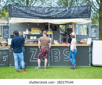 AMSTERDAM, THE NETHERLANDS - MAY 17, 2015: Mobile kitchen Zebs sells Italian cuisine dishes during the annual mobile kitchens weekend, held in the city's Culture park.