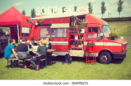 AMSTERDAM, THE NETHERLANDS - MAY 17, 2015: Mobile kitchen Soep en Salade sells soups and salad during the annual mobile kitchens weekend, held in the city's Culture park. Instagram-like filter applied
