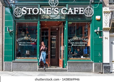Amsterdam, Netherlands - May 18, 2019: Relaxing in front of the Stones Cafe