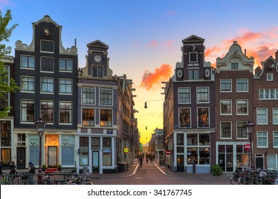 AMSTERDAM, THE NETHERLANDS - MAY 2, 2014: Beautiful sunset at one of nine little streets, a popular touristic destination in Amsterdam, The Netherlands, on May 2, 2014