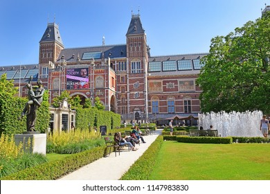 Amsterdam, the Netherlands - May 20, 2018: people rest at the fountain in the Rijksmuseum garden in sunny day