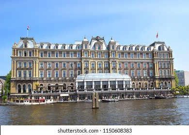 Amsterdam, the Netherlands - May 20, 2018: the famous five star Amstel hotel at the bank of the Amstel river, The Amstel Hotel is part of the InterContinental Hotels chain