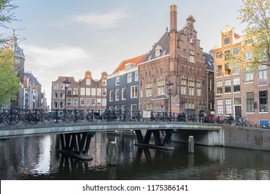 AMSTERDAM, NETHERLANDS - MAY, 2015: boats on the canal in Amsterdam, the capital of Netherlands on May 2015