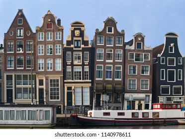 Amsterdam, Netherlands, May 2018: Classic crooked Amsterdam buidlings at house boats, Netherlands
