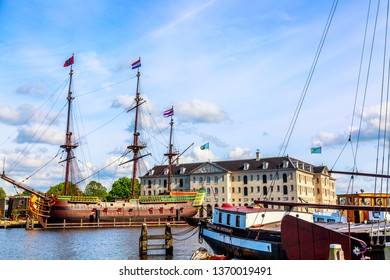 Amsterdam, The Netherlands - May, 2018: National Maritime Museum Scheepvaartmuseum in Amsterdam with old replica ship.