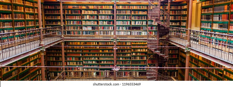 Amsterdam, Netherlands - May 2018: A wide angle shot showing the books in the Rijksmuseum Research Library, largest public art history research library in the Netherlands.