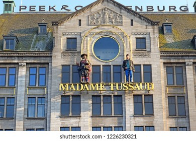 Amsterdam, The Netherlands - May 21, 2018: front facade of wax museum Madame Tussauds Amsterdam on the Dam Square, Netherlands