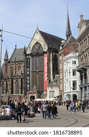Amsterdam, The Netherlands - May 23, 2019: Tourists at the Nieuwe Kerk church on Dam square in Amsterdam, The Netherlands on May 23, 2019