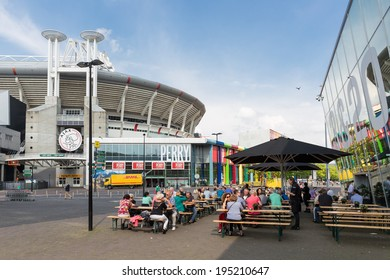 AMSTERDAM, THE NETHERLANDS - MAY 23: People sitting at a terrace near the soccer stadium from the Dutch football club Ajax on May 23, 2014 in Amsterdam, the Netherlands