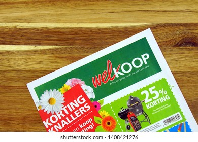 Amsterdam, the Netherlands - May 26, 2019: Garden and animal store sale flyer or advertising brochure, of Dutch retail chain Welkoop, against a wooden background.
