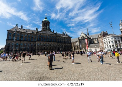 AMSTERDAM, NETHERLANDS - MAY 27, 2017: Exterior view of Paleis op de Dam Koninklijk in the old town part of Amsterdam on May 27, 2017. Amsterdam is popular by tourist for historical houses and canals.