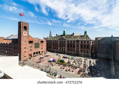 AMSTERDAM, NETHERLANDS - MAY 27, 2017: View of Beurs van Berlage at Damrak street in the old town part of Amsterdam on May 27, 2017. Amsterdam is popular by tourist for historical houses and canals.