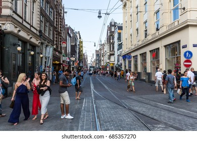 AMSTERDAM, NETHERLANDS - MAY 27, 2017: View of people shopping and tourists at the Leidsestraat Street in the city centre of Amsterdam on May 27, 2017. Its between Koningsplein and Prinsengracht.