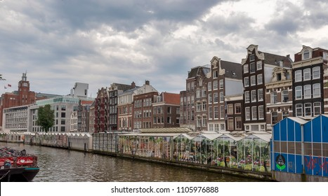 AMSTERDAM, NETHERLANDS - MAY 27, 2018: General view of the Flower Market (in Dutch: Bloemenmarkt) at the Singel Canal.