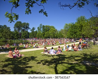 Amsterdam, the Netherlands, May 28, 2013: Lots of people sunbathing in the Vondelpark on a sunny day.