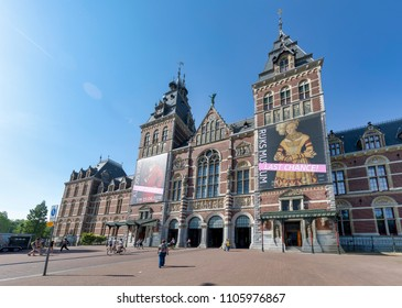 AMSTERDAM, NETHERLANDS - MAY 28, 2018: General view of the National Museum (in Dutch: Rijksmuseum) from the Museumbrug Bridge.