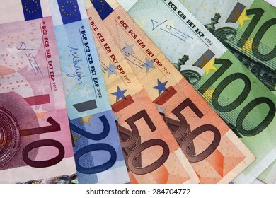 Amsterdam, Netherlands - May 29, 2015: : illustrative editorial image of close up of European banknotes of 100.50, 20.10 Euro