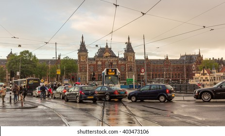 AMSTERDAM, NETHERLANDS - MAY 29, 2015: A traffic jam in front of Amsterdam Centraal station. The Amsterdam region is one of the busiest regions of the Netherlands.