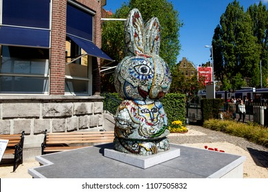 "AMSTERDAM, NETHERLANDS - MAY 3, 2018: Photo of Two-meter mosaic statue of the Dutch rabbit Miffy (miffy) at the diamond factory ""Bonfire Diamond""."