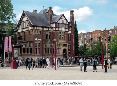 Amsterdam, Netherlands - May 31, 2019: crowd in front of the Moco Museum (Modern Contemporary Museum) in Amsterdam. Sunny day.