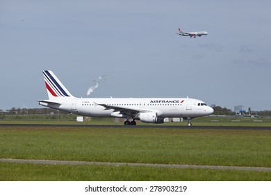 AMSTERDAM, THE NETHERLANDS - MAY, 4. An Airbus A320-214 of Air France lands at Amsterdam Airport Schiphol (The Netherlands, AMS) on May 4, 2015. The name of the runway is Polderbaan.