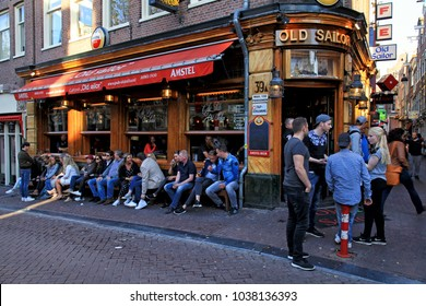 AMSTERDAM, NETHERLANDS - MAY 5, 2016: Tourists and local people enjoy the datch pub 'Old sailor' in Red Light District, Amsterdam, Netherlands