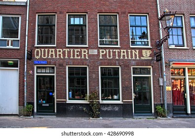 AMSTERDAM, NETHERLANDS - MAY 5, 2016: Amsterdam's red lights district near Oude Kerk(Old Church) in Amsterdam, Netherlands.