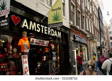 AMSTERDAM, NETHERLANDS - May 6, 2013: Souvenir shop in the red light district where the public can buy drugs