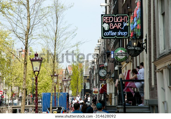 AMSTERDAM, NETHERLANDS - May 6, 2013: Shop signs in De Wallen alleys of the red light district